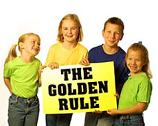 "Children holding a poster that reads ""The Golden Rule"""