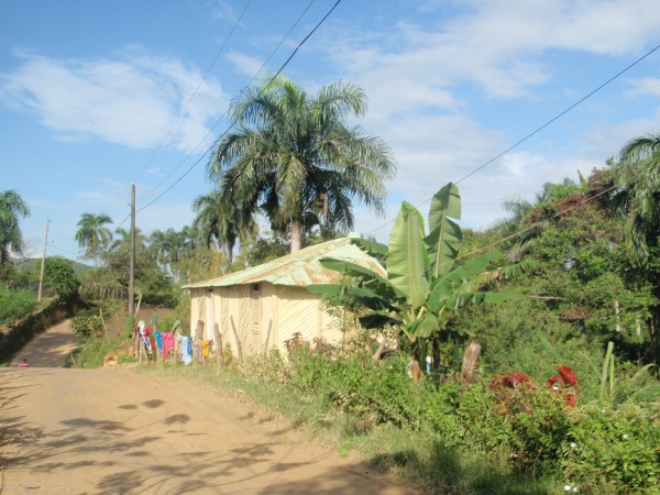 A house on a dirt road in the Dominican Republic.