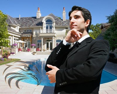 A man in front of a large house
