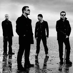 U2 posing on the beach