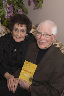 """Ross Wightman with his book """"Is a Pastor's Life Dull"""""""