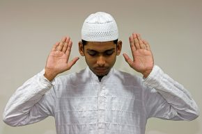 A Muslim man engaged in Muslim prayer