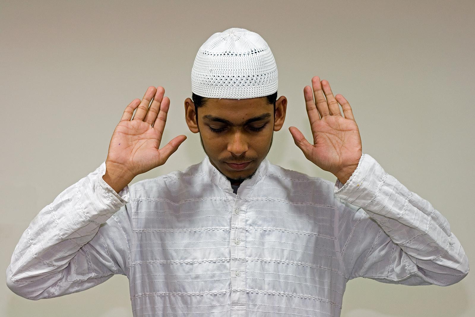 A Muslim man engaged in Muslim prayer