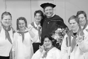 Pastor Joy Gregory, with supporters at a special convocation in February where she received her doctorate.