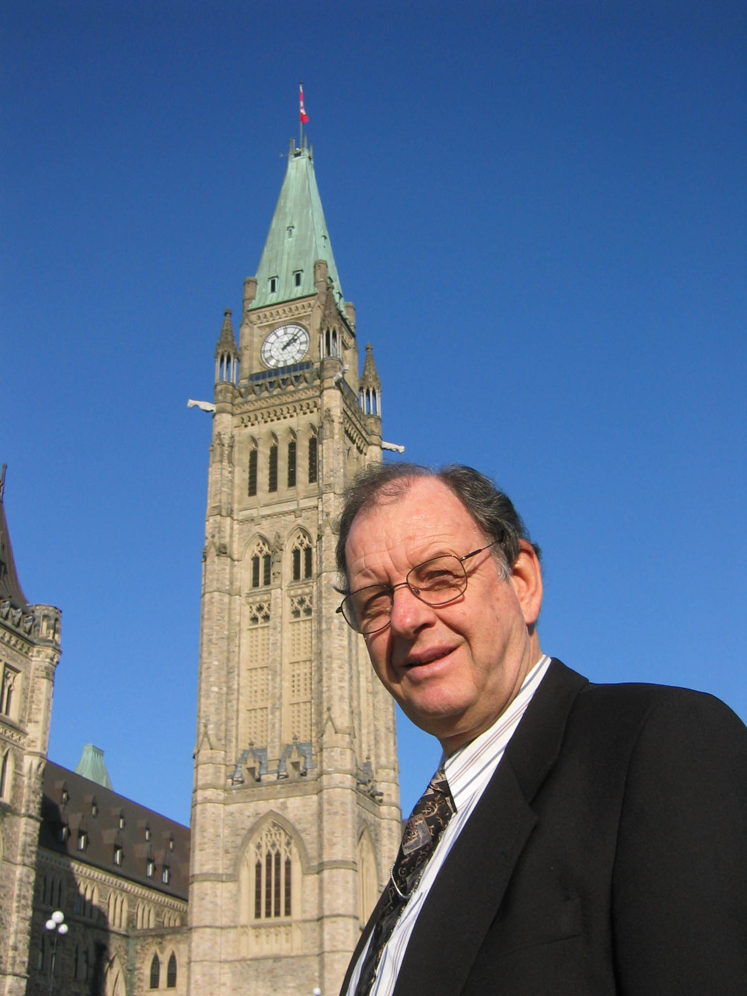 Lloyd Mackey in front of the Peace Tower on Parliament Hill in Ottawa