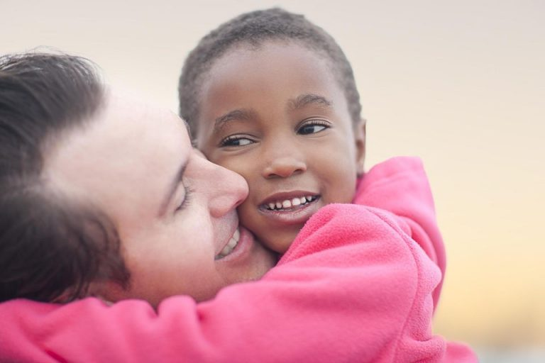 Man hugging a child